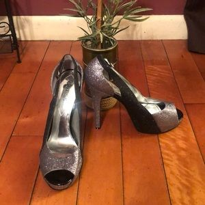 Guess High heels in silver and black.